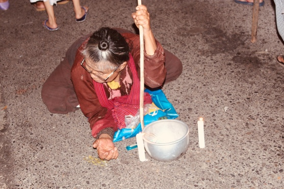 An old lady begging at the Thadingyut festival